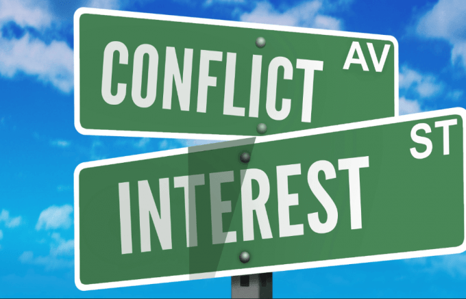 Street signs saying Conflict and Interest